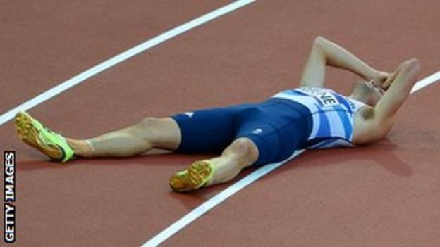 Dai Greene lies on the track looking desolate.