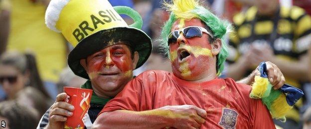 Spain fans watch the match against Australia in Curitiba