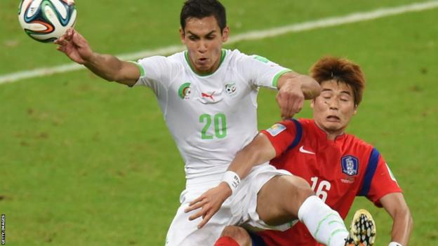 Algeria's defender Aissa Mandi (left) fights for the ball with Swansea City midfielder Ki Sung-Yueng during South Korea's 2-4 defeat in their Group H clash at the World Cup in Brazil