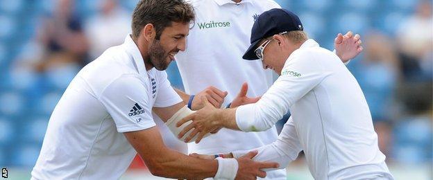 England's Liam Plunkett and Joe Root