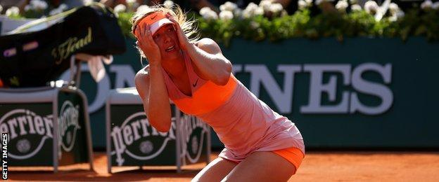 Maria Sharapova celebrates winning the French Open 2014