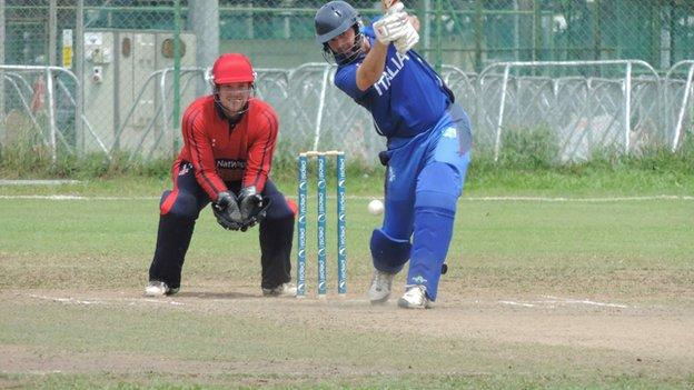 Jersey wicketkeeper Ed Farley looks on as Italy bat