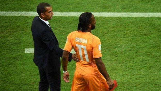 Sabri Lamouchi and Didier Drogba