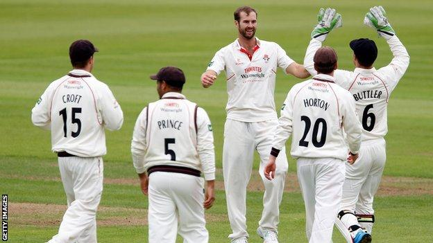 Lancashire all-rounder Tom Smith celebrates another wicket