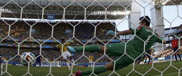 Colombia winger Juan Cuadrado scores a penalty against Japan