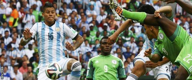 "Argentina""s Marcos Rojo (left)"