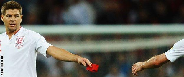 Steven Gerrard handing over the captain's armband to Frank Lampard