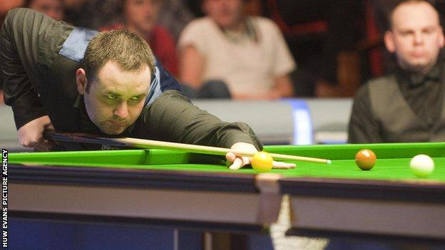 Stephen Maguire takes a shot