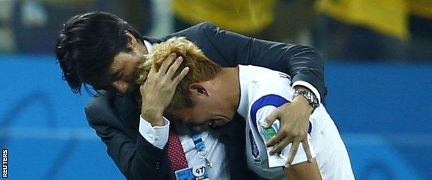 South Korea manager Hong Myung-bo consoles one of his players