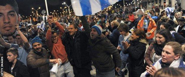 Fans wait for Luis Suarez at Carrasco International Airport near Montevideo