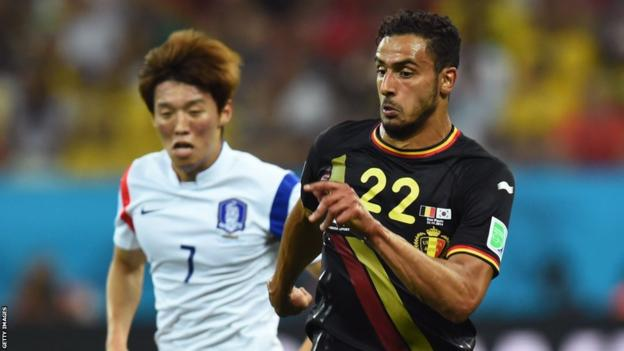 Cardiff City's Kim Bo-Kjung (left) chases Belgium's Nacer Chadli during South Korea's 1-0 defeat in Group H at the World Cup in Brazil.