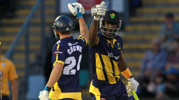 Glamorgan's Chris Cooke (left) and Darren Sammy celebrate another boundary during the Welsh County's T20 Blast defeat against Hampshire in Cardiff.