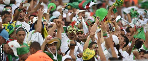Algeria fans celebrate reaching the last 16 for the first time