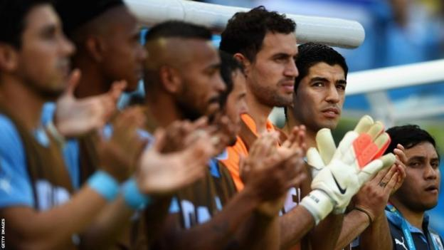 Luis Suarez of Uruguay (right) applauds from the bench during the 2014 Fifa World Cup Group D match between Uruguay and Costa Rica at Castelao on 14 June 14 in Fortaleza