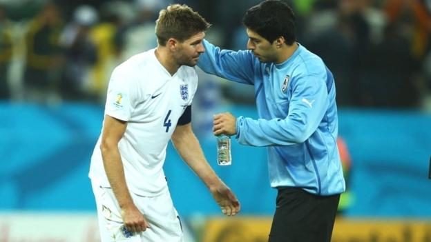 Luis Suarez of Uruguay consoles Steven Gerrard of England after Uruguay's 2-1 victory in the 2014 Fifa World Cupl Group D match between Uruguay and England at Arena de Sao Paulo