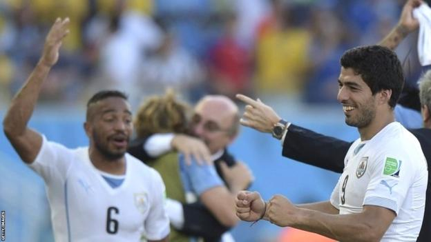 Uruguay forward Luis Suarez (right) celebrates their victory at the end of a Group D football match between Italy and Uruguay at the Dunas Arena in Natal