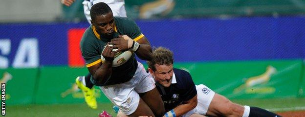 South Africa's Lwazi Mvovo crosses the line for his first try of the match
