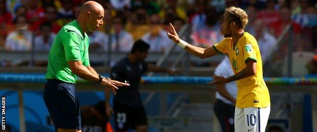 English referee Howard Webb and Brazil's Neymar