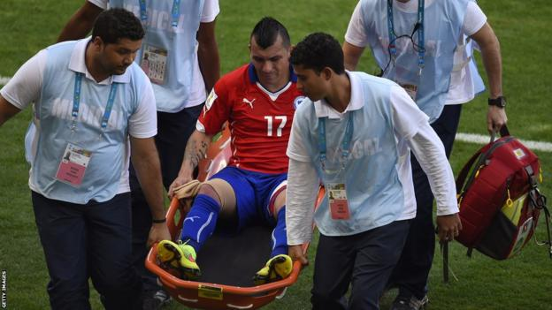 Cardiff City's Gary Medel is stretchered off in extra-time as Chile lose to hosts Brazil in the World Cup last 16 on penalties