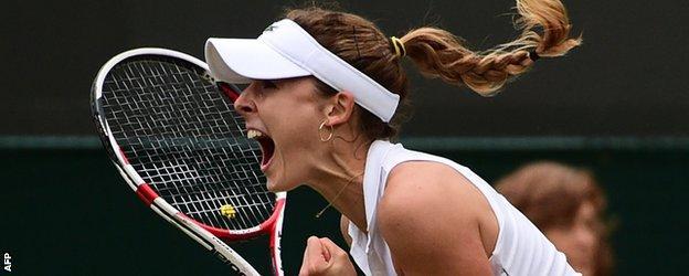 Alize Cornet celebrates beating Serena Williams at Wimbledon