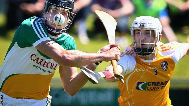 Offaly's Conor Mahon is challenged by Antrim defender Conor McKinley