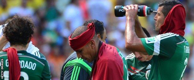 Mexico players enjoy the cooling break