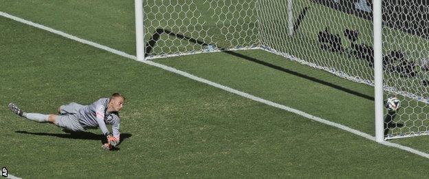 Giovani dos Santos scores past Jasper Cillessen (pictured)