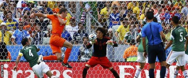 Guillermo Ochoa makes a save from Stefan de Vrij