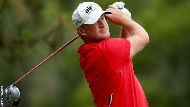 Golfer Jamie Donaldson plays a shot.