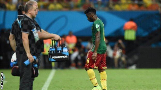 Cameroon midfielder Alex Song (right