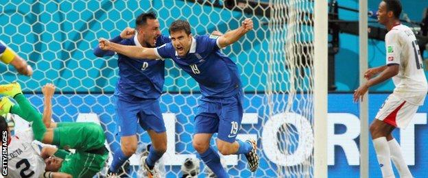 Greece's Sokratis Papastathopoulos celebrates a late equaliser against Costa Rica