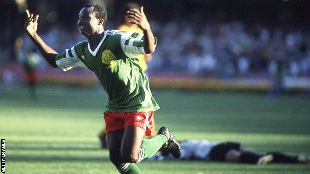 Cameroon's Roger Milla celebrates scoring against Colombia in 1990