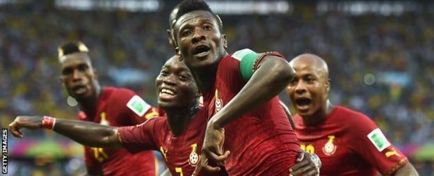 Asamoah Gyan celebrates scoring against Germany