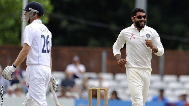 India's Ravindra Jadeja celebrates the wicket of Derbyshire's Ben Slater (left)
