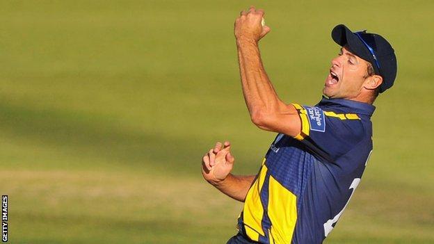 Dean Cosker celebrates a wicket for Glamorgan