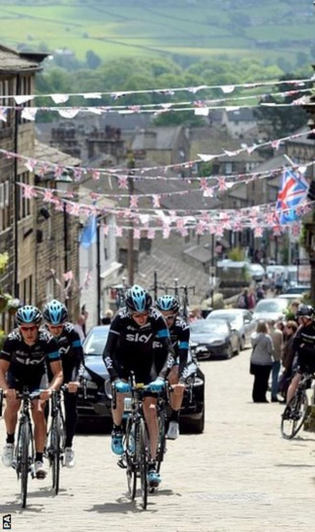 Chris Froome (front right ) rides alongside Richie Porte as the Sky riders climb the cobbled hill at Haworth in preparation for the Tour