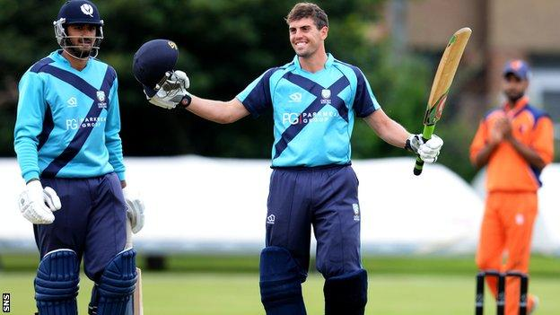 Calum MacLeod celebrates after securing his century in Scotland's triumph