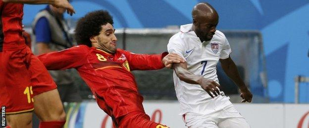 Marouane Fellaini tackles USA's DaMarcus Beasley
