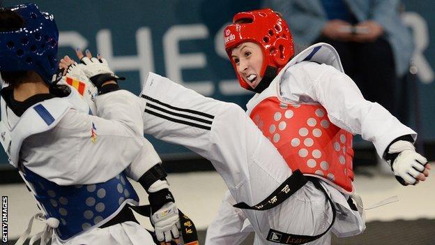 Jade Jones kicks her opponent