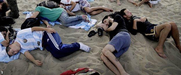 Fans sleep on the beach at the 2014 World Cup