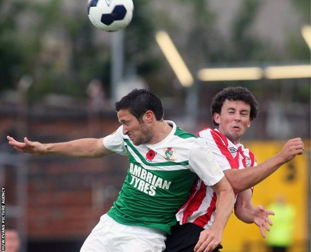 Derry City's Barry McNamee challenges Aberystwyth Town's Antonio Corbisiero in the Europa League tie at the Brandywell Stadium.