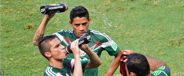 Mexico players take a 'cooling break' at the 2014 World Cup