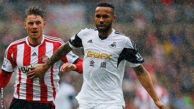 Kyle Bartley challenges for the ball with Connor Wickham
