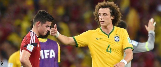 Brazil defender David Luiz consoles Colombia striker James Rodriguez