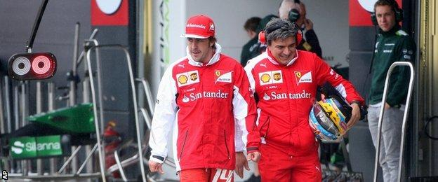 Fernando Alonso (left)