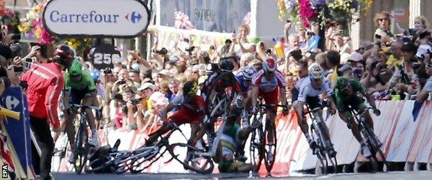 The crash involving Mark Cavendish (left) and Simon Gerrans (centre)