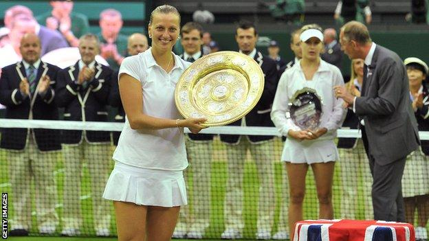 Petra Kvitova poses with the winner's Venus Rosewater Dish