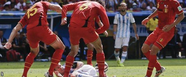Belgium players foul Lionel Messi