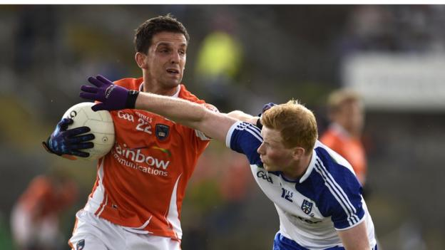 Armagh's Stephen Harold attempts to shrug off the attention of Paudie McKenna during the replay