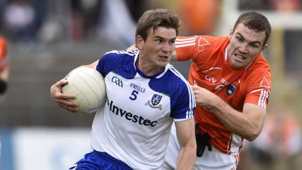 Monaghan's Dessie Mone attempts to escape the clutches of Brendan Donaghy